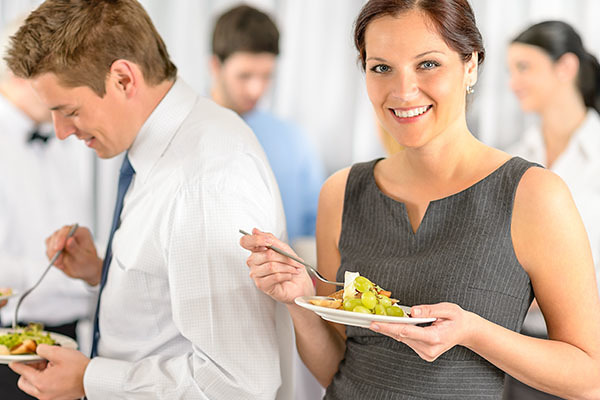 limonzest120500381.jpg - smiling business woman during company lunch buffet hold salad plate